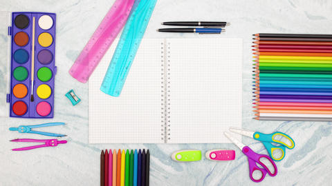Stop motion of school supplies moving around notebook Stock Video Footage