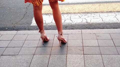 Slender female legs in elegant shoes at the pedestrian crossing. City life Footage