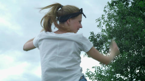 Young beautiful girl in the park is dancing fun in the park Footage
