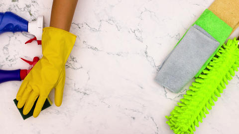 Stop motion animation of hand with yellow gloves clean the table with sponge Animation