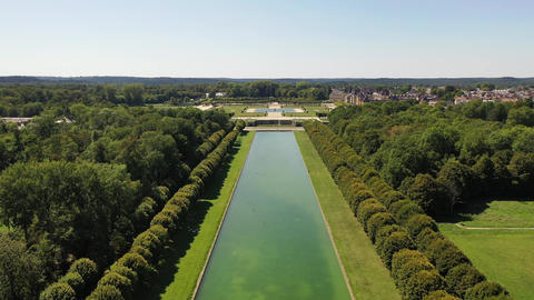 Aerial view of medieval landmark royal hunting castle Fontainbleau and lake with Live Action