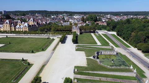 Aerial view of medieval landmark royal hunting castle Fontainbleau near Paris in Live Action