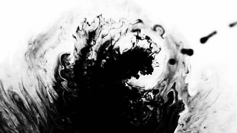 Black blot fills the frame Live Action