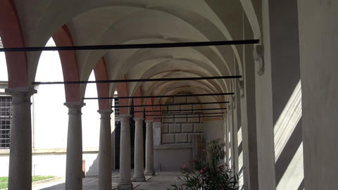 Old arcade, corridor and flowers in the pots. Elements of architecture of buildings, ancient arches, Live Action