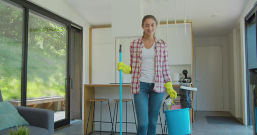 Happy cleaning service employee ready to start working, positive work attitude Footage
