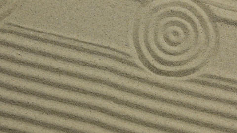 Concentric circles and lines on the sand. Crane shot. Texture of sand Live Action