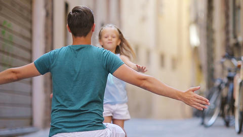Family in Europe. Happy father and little adorable girl in Rome during summer Live Action