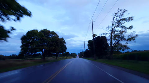 Driving Rural Countryside Wet Road Under Overcast Cloudy Sky in Day. Driver Point of View POV After Footage