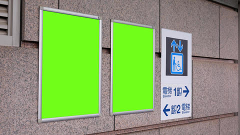 Motion of two green billboards and direction sign on wall at Taipei main station with 4k resolution Live Action