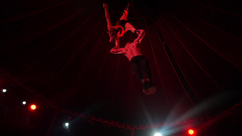 Aerial acrobats - amazing tricks, woman and man Footage
