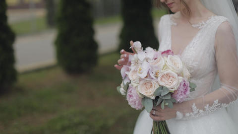 Wedding bouquet in the hands of the bride. Wedding day. Engagement Live Action
