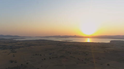 Top view of beautiful golden sunrise above sea horizon, view from island Footage