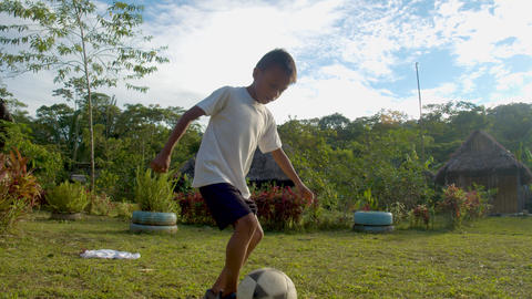 Young Indigenous Boy Plays With A Football Ball Outside In His Native Village In Ecuador Footage