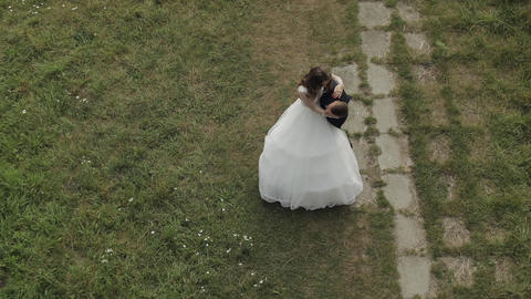 Caucasian groom with bride in the park. Wedding couple. Happy family. Newlyweds Live Action