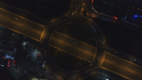 Roundabout road with night traffic in city at night. Night, Top view of Sofia Live Action