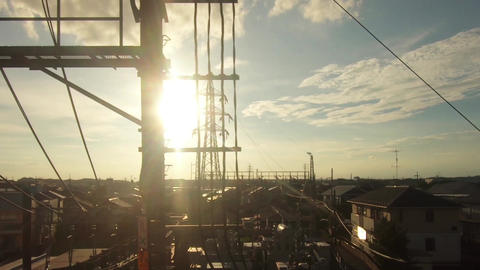 Japan Railway train window. Sunlight and residential area Footage