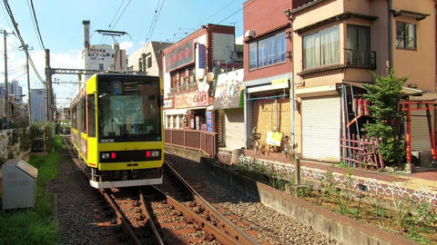 Japanese urban landscape, small station and train in Tokyo Footage