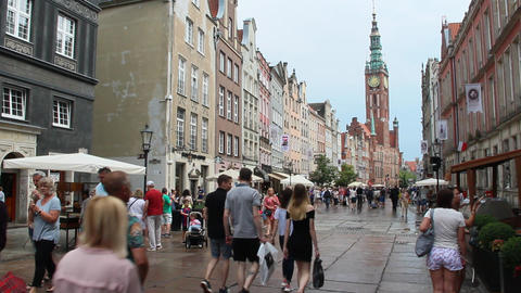 Tourists stroll on Gdansk during rain. Europian tourists during journey Live Action