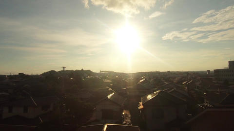Japan Railway train window. Evening sunshine and residential area Live Action