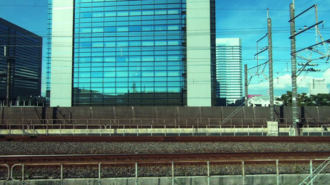 Japan Railway train window. Urban landscape. Near Makuhari subcenter Footage