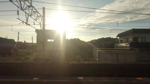 Japan Railway train window. Sunset and train departure Live Action