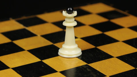 Rotation. Chess figure white queen on chess board. Close-up Footage