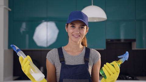Young smiling woman from cleaning service comparing two… Stock Video Footage