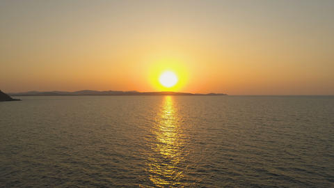 Golden Sunset over island with calm sea and clear sky Footage