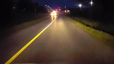 Driving Long Road at Night With Oncoming Vehicle Flashing High Beams. Driver Point of View POV of Footage