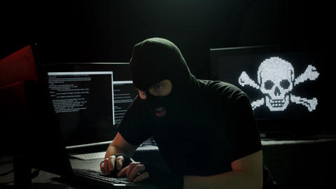 Hacker in T Shirt Stealing Data Live Action