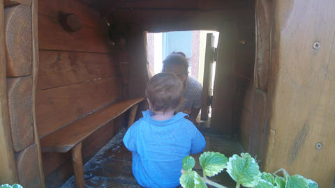 Baby boy in a wooden house Footage