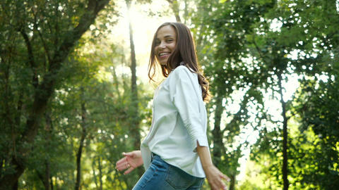 Close up portrait of Young feminine brunette girl smiling and dancing in Slow Live Action