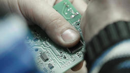 A worker is working on the creation of an electronic board. Close-up Footage