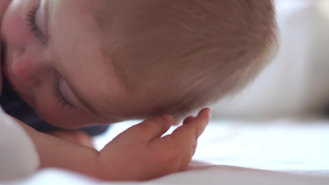Little blonde boy turns his head in a dream in slow motion, Live Action