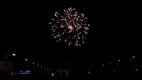 Colourful fireworks in the night sky above city square Live Action