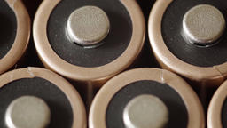 AA batteries in extreme close up UHD stock footage Footage