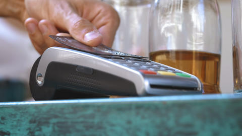 NFC credit card payment. Male hand of customer paying with contactless credit Footage