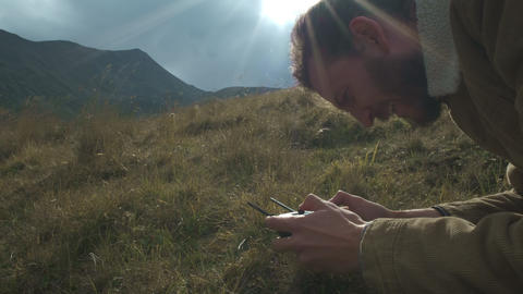 Remote control drone in the male hands of the pilot close-up. Man navigation Live Action