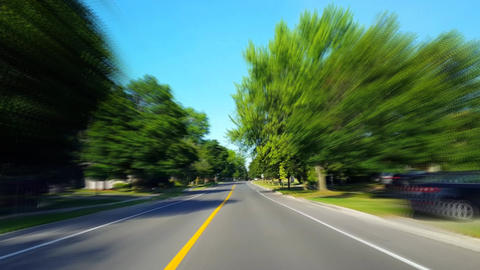 *Drunk Motion Blur Intoxicated Version* Driving Residential City Road With Lush Trees During Summer Live Action