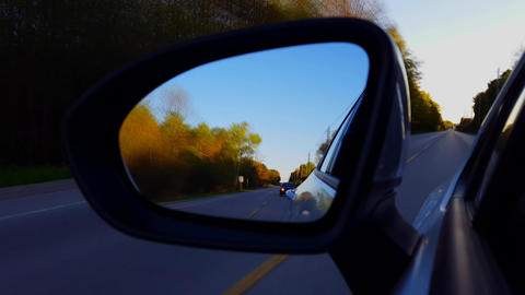 *Motion Blur Version* Driving Rural Road View of Side Mirror in Daytime. Driver Point of View POV Live Action