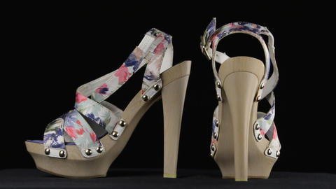 Pair of women's high-heeled shoes. Rotation Live Action