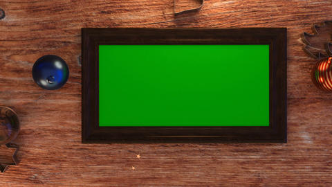 Top view of green screen photo frame on wooden table with christmas decoration Animation