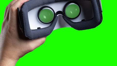 left hand coming out with VR device and zoom in front of green screen Animation