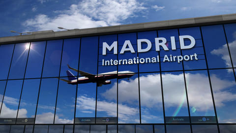 Airplane landing at Madrid mirrored in terminal Live Action