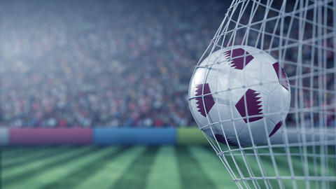 Flag of Qatar on the ball in football net. Conceptual 3D animation Footage