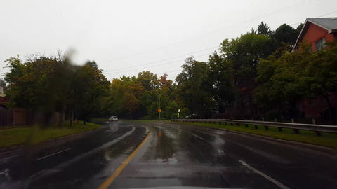 Driving Rain City Street Under Overcast Sky in Summer Day. Driver Point of View POV Raining Urban Live Action