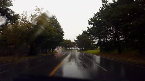 Driving Rain City Street Under Overcast Sky in Summer... Stock Video Footage