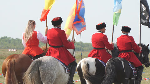 Cossacks in traditional uniform with flags on horses Live Action