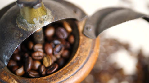 Aromatic Coffee Beans in Old Vintage Grinder Live Action