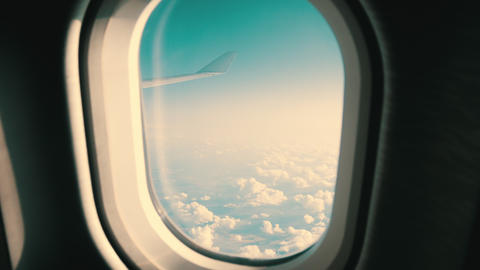 Traveling concept - view from airplane porthole to the blue sky and clouds Footage